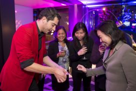 Roving Close Up Magic - Magician Sydney - Liam Power Sydney Magician performing roving close up magic at a corporate event
